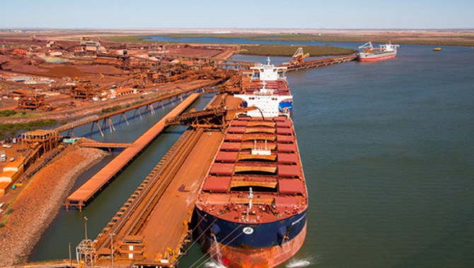 China's iron ore port stocks up on easing jam